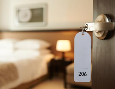 hotel-room-door-opening-to-reveal-bed-kenosha-wi