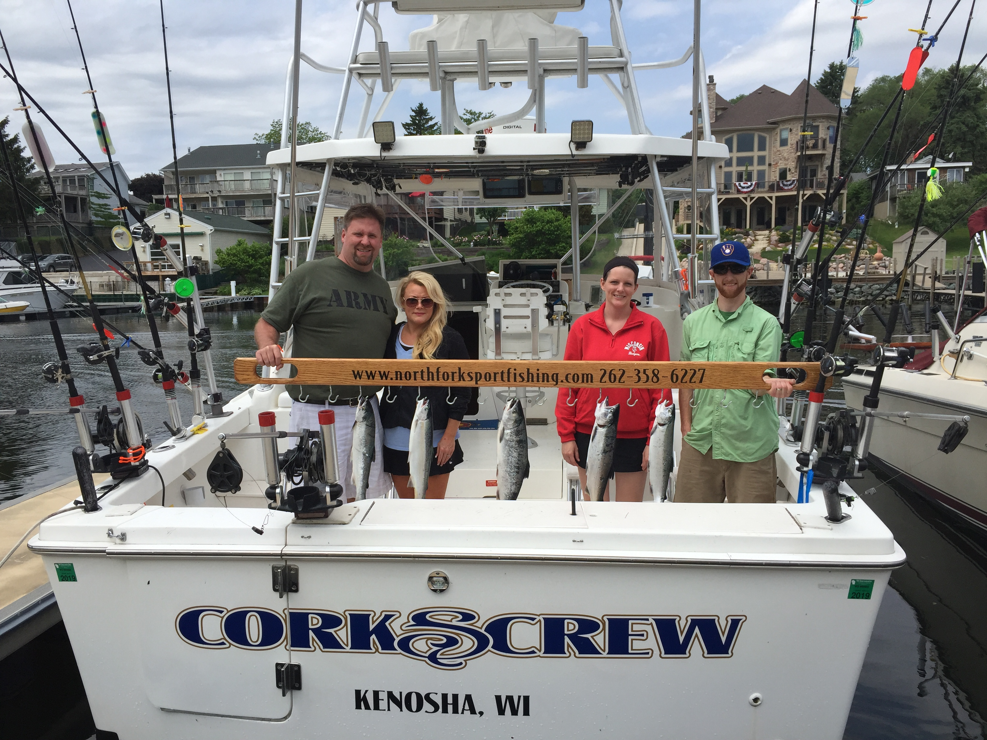 2-couples-on-charter-fishing-with-trout