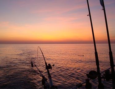 calm-sunset-off-back-of-boat-on-lake-michigan